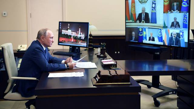 Russian President Putin attends a meeting of the Collective Security Treaty Organization (CSTO), via a video link outside Moscow