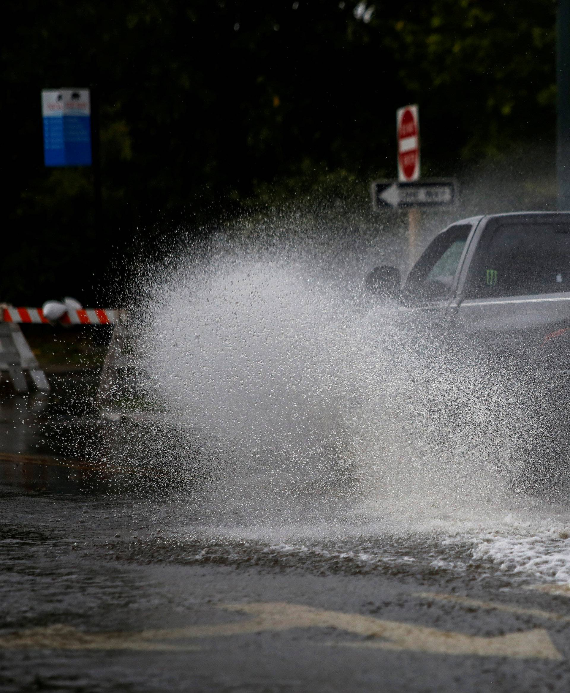 A man drives his vehicle around the Union Point Park Complex through floodwaters as the Hurricane Florence comes ashore in New Bern, North Carolina