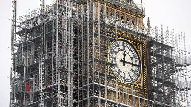 FILE PHOTO: The Elizabeth Tower, housing the Big Ben bell, is seen clad in scalffolding, over the Houses of Parliament, in central London