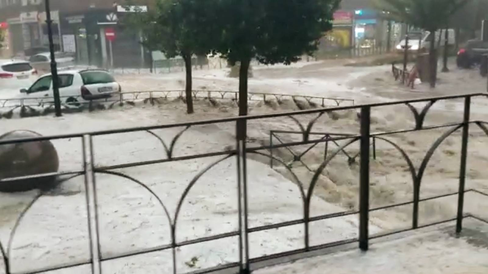 Cars are seen during the heavy rains in Arganda del Rey, Madrid
