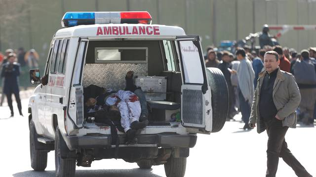 Victims are carried away in an ambulance after a blast in Kabul