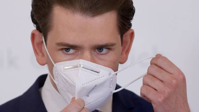 Austria's Chancellor Kurz arrives for a news conference in Vienna