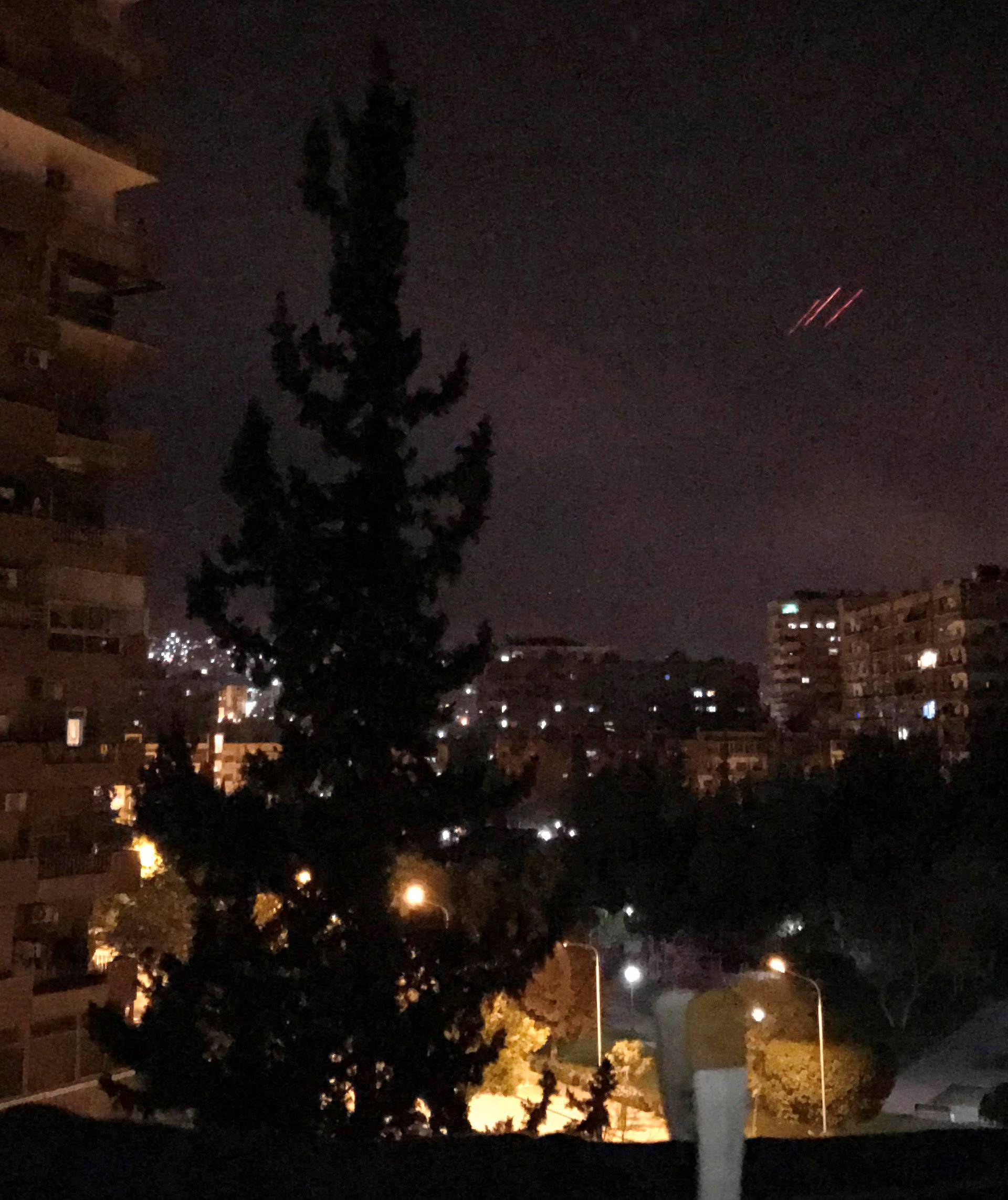 Anti-aircraft fire is seen over Damascus,Syria