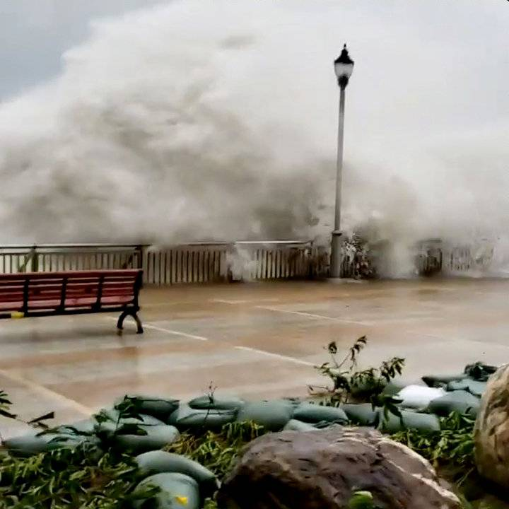 Waves spilling over a sea barriers as Typhoon Mangkhut approaches Hong Kong