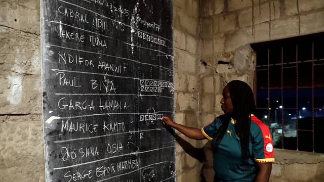 An election worker takes part in vote counting during the presidential election in Yaounde,