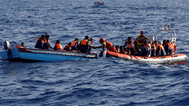An inflatable boat from the Spanish vessel Astral operated by the NGO Proactiva collects migrants off the Libyan coast in the Mediterranean Sea