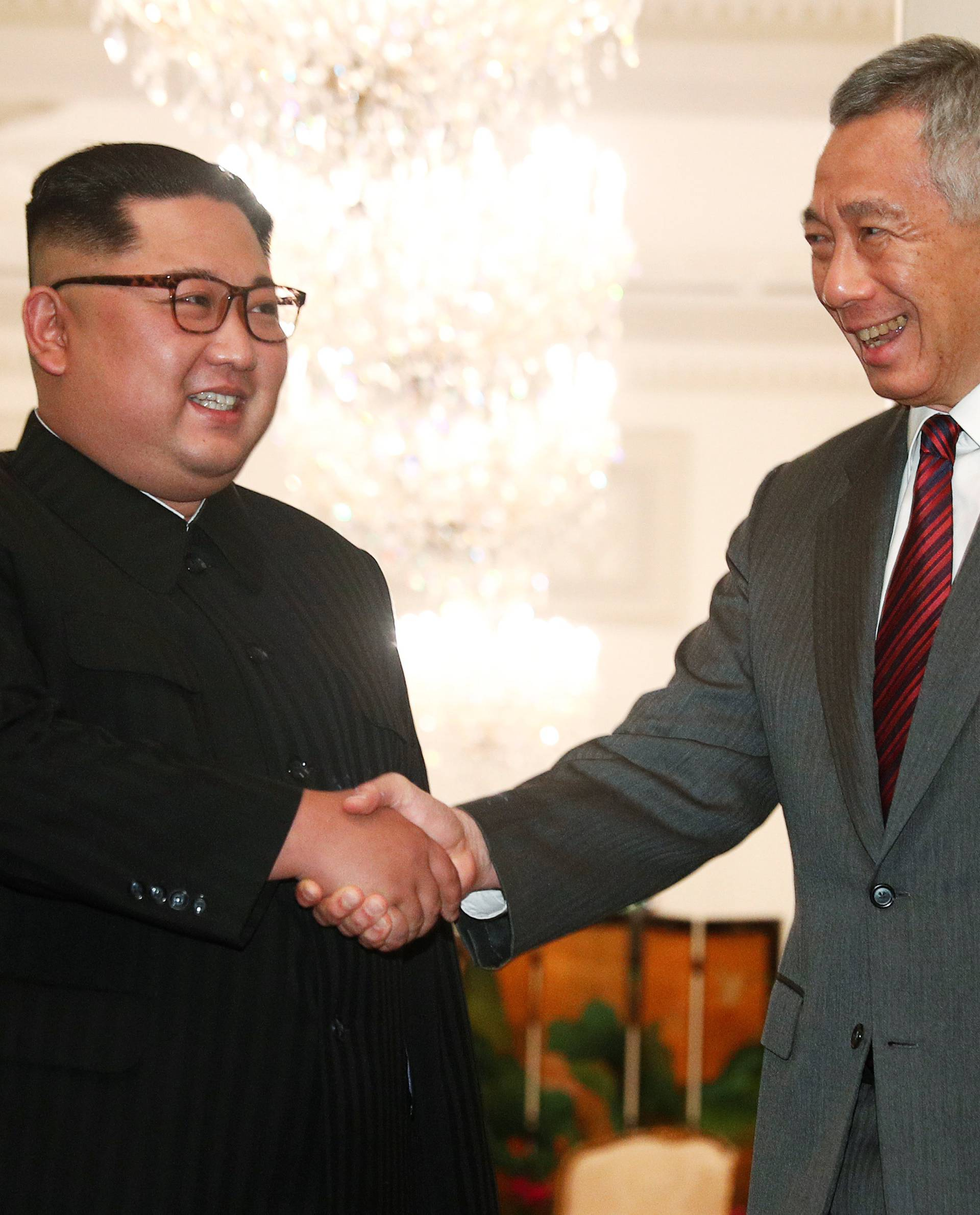 North Korea's leader Kim Jong Un shakes hands with Singapore's Prime Minister Lee Hsien Loong at the Istana in Singapore