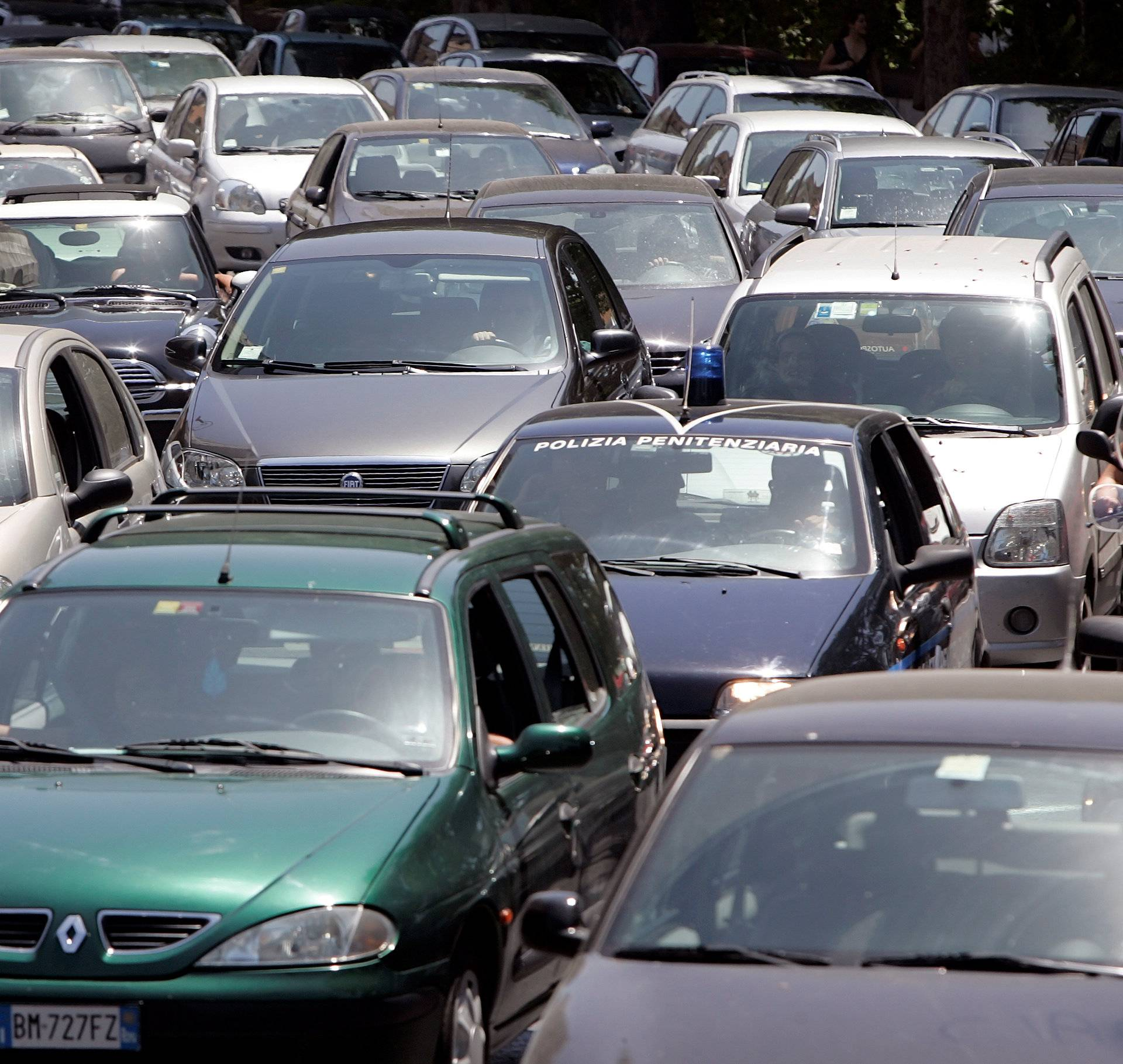 Cars are seen stuck in a traffic jam in downtown Rome