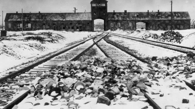 """FILE PHOTO: An undated archive photograph shows Auschwitz II-Birkenau's main guard house which prisoners called """"the gate of death\"""