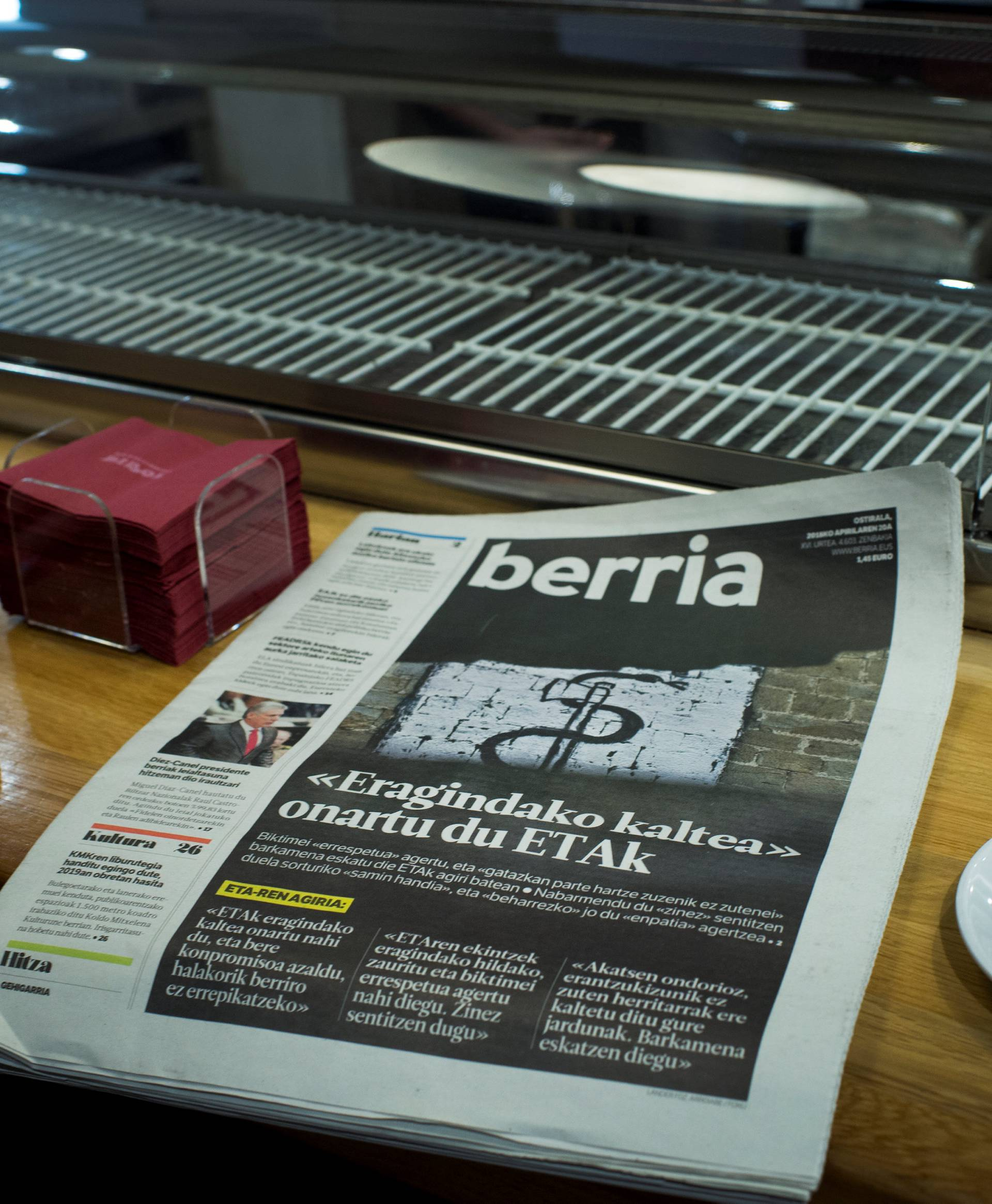 Basque language newspaper Berria displays a photograph with the symbol of armed Basque separatists ETA following groups apology, in Bilbao