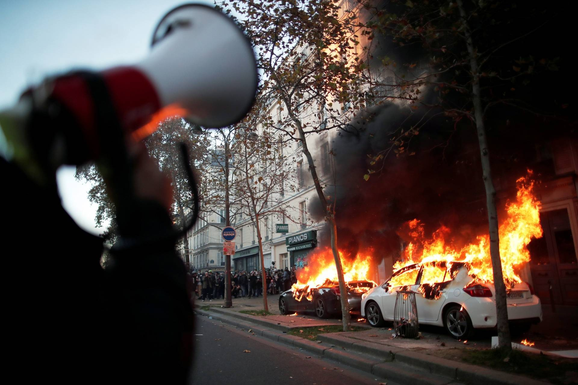 Protests over proposed curbs on identifying police, in Paris