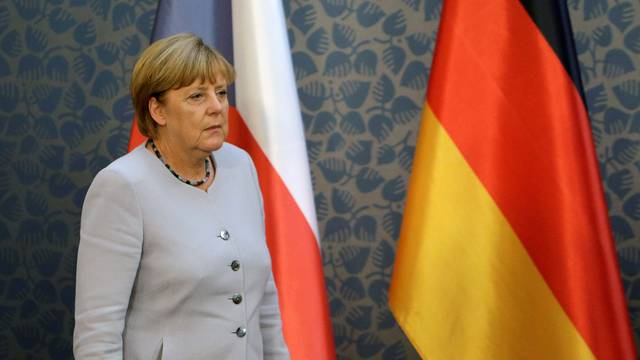 Merkel arrives at a news conference at Czech government headquarters in Prague