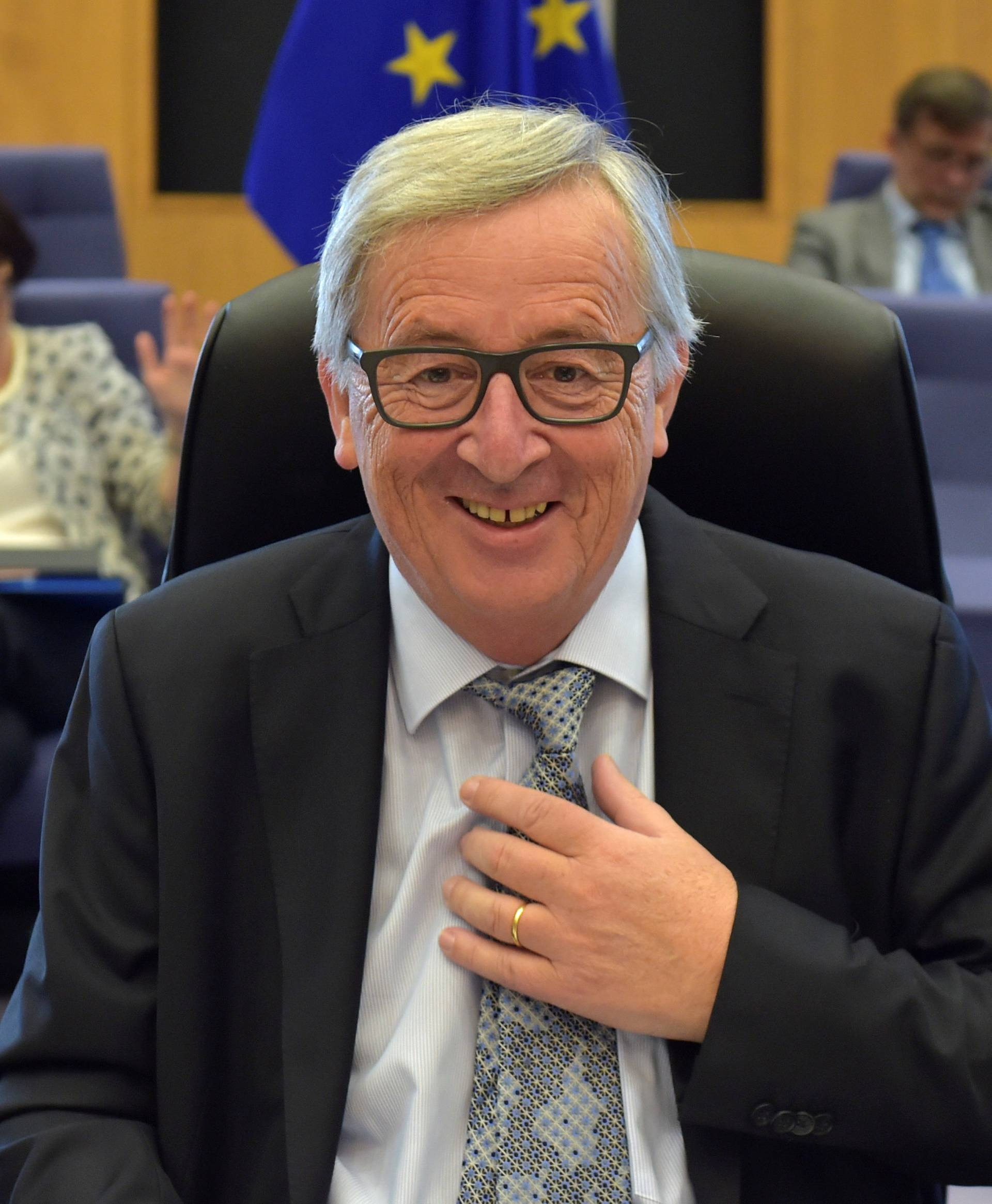 EC President Juncker gestures before a meeting of the College of Commissioners in Brussels