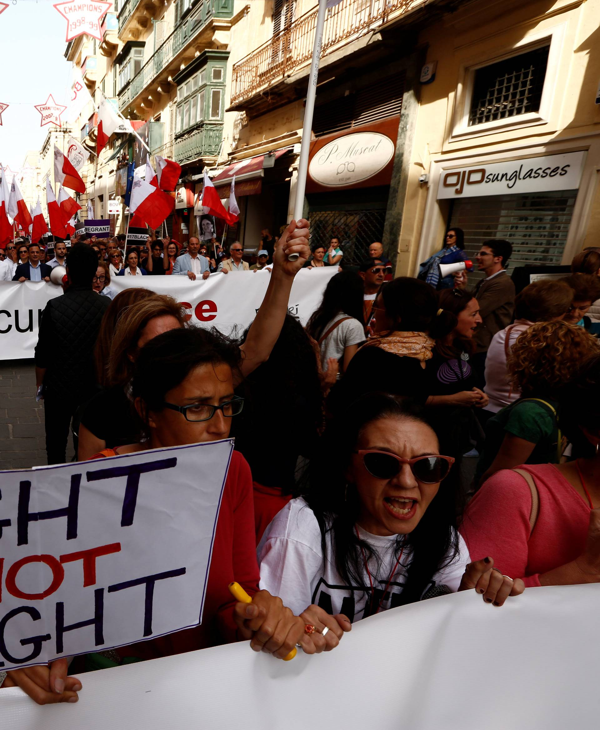 People shout slogans during a protest against government corruption in light of the revelations in the Daphne Project, in Valletta