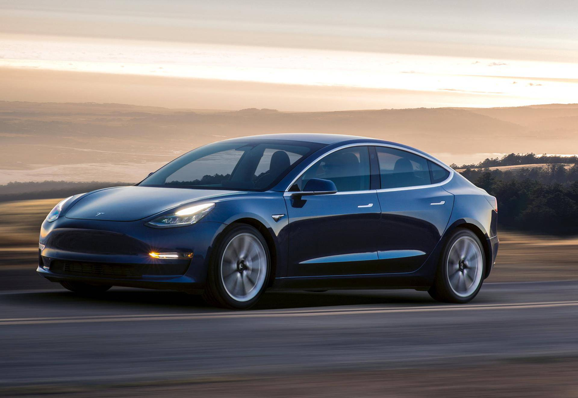 A Tesla Model 3 sedan is seen in this undated handout image as the car company handed over its first 30 Model 3 vehicles to employee buyers at the company's Fremont facility