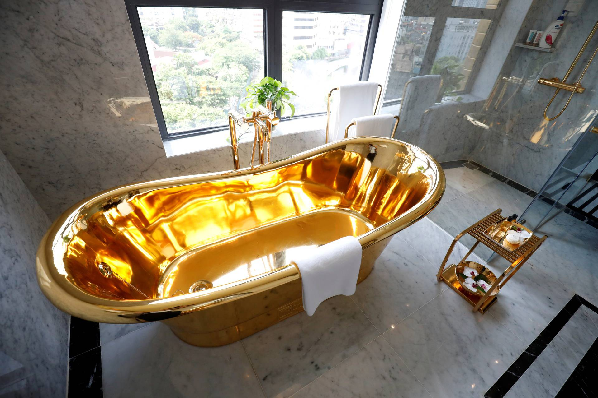 FILE PHOTO: A gold-plated bathtub is seen in the newly inaugurated Dolce Hanoi Golden Lake luxury hotel, after the government eased a nationwide lockdown following the global outbreak of the coronavirus disease (COVID-19), in Hanoi, Vietnam