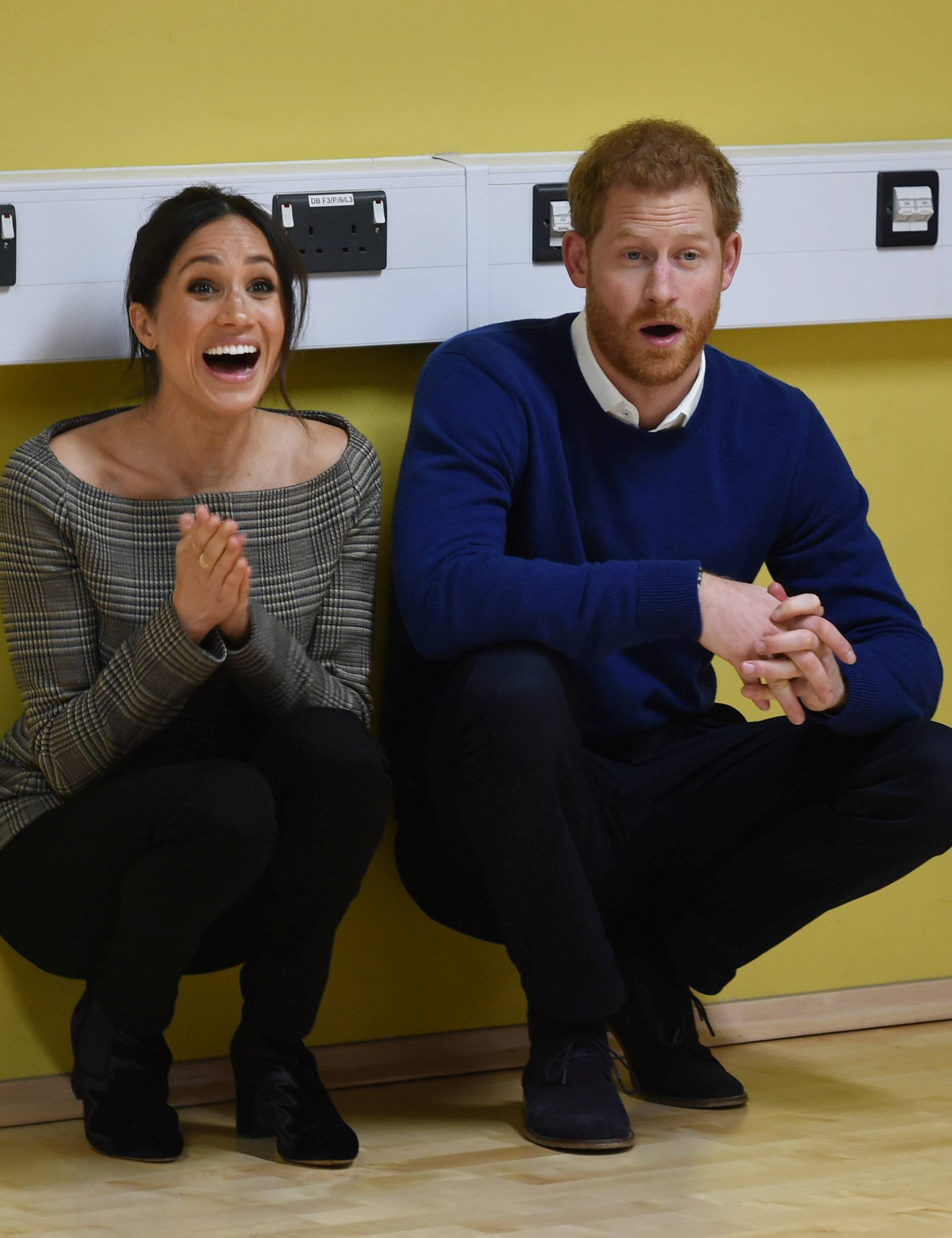 Britain's Prince Harry and his fiancee Meghan Markle watch a street dance class during their visit to Star Hub, a community and leisure centre, in Cardiff