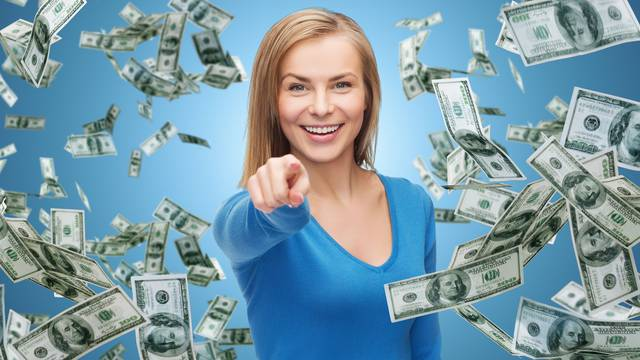 smiling woman with money pointing finger on you