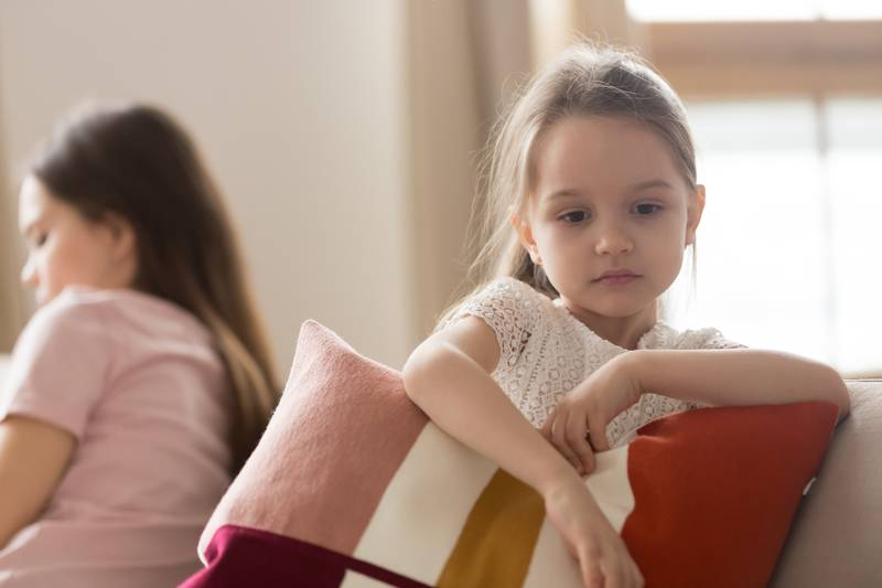Upset kid daughter feeling sad after fight with mother
