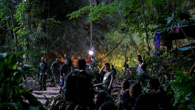 Military personnel gather as they prepare to go in to Tham Luang cave complex, as members of an under-16 soccer team and their coach have been found alive according to local media in the northern province of Chiang Rai