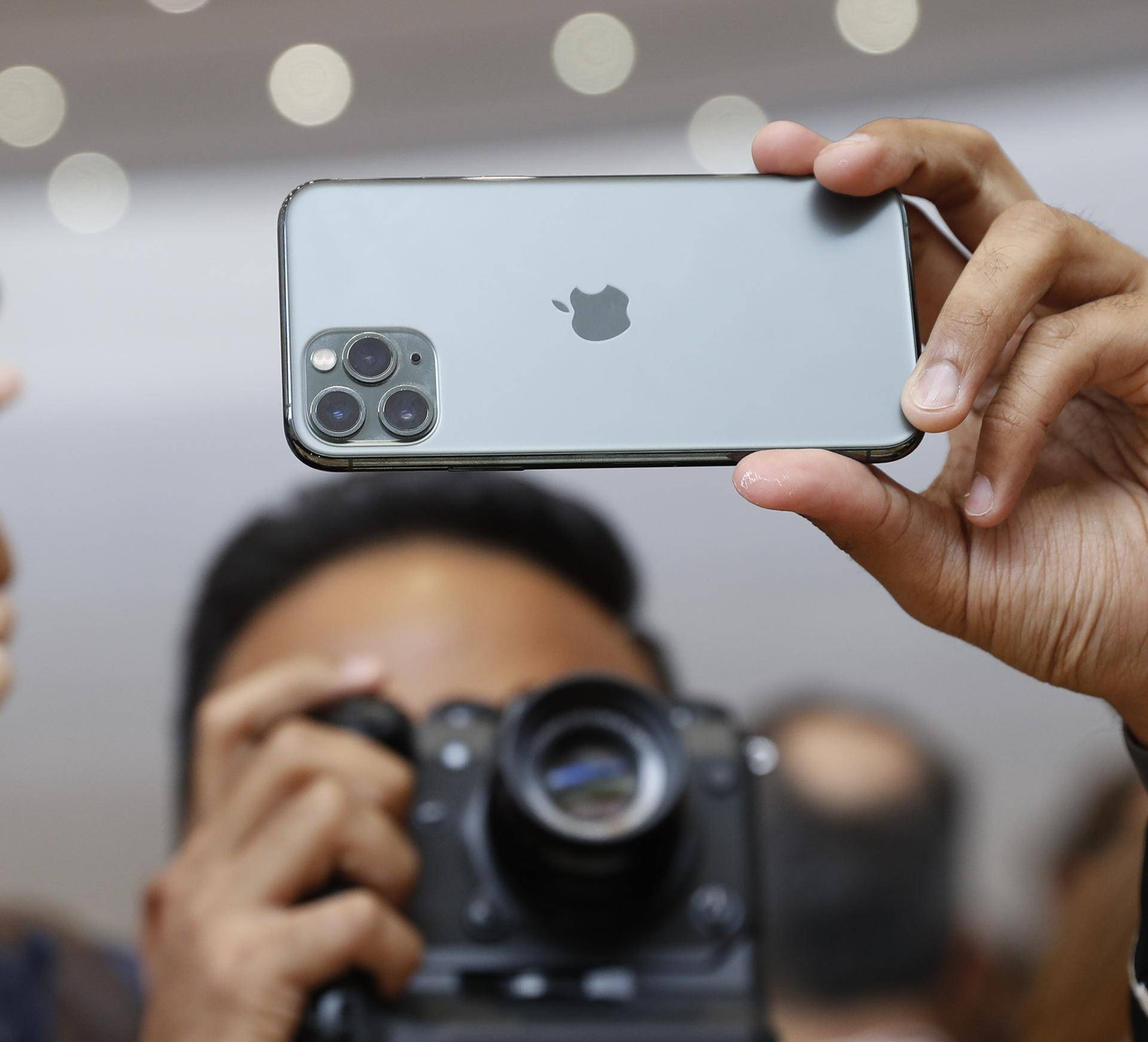 People take photos of the new iPhone  11 Pro in the demonstration room at an Apple event at their headquarters in Cupertino