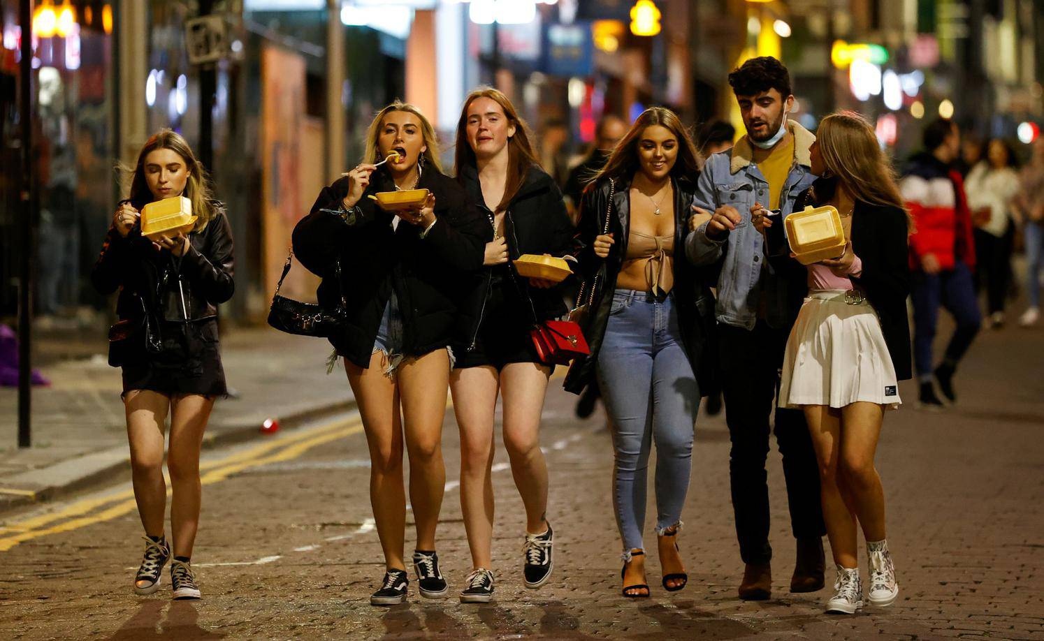 People walk and gather outside bars the night before a local lockdown amidst the spread of the coronavirus disease (COVID-19) in Liverpool