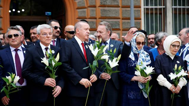 Members of Bosnian Presidency Zeljko Komsic and Sefik Dzaferovic, Turkey's President Recep Tayyip Erdogan with his wife Emine Erdogan and Bakir Izetbegovic pay their respects at a convoy carrying remains of the Srebrenica genocide victims, in Sarajevo