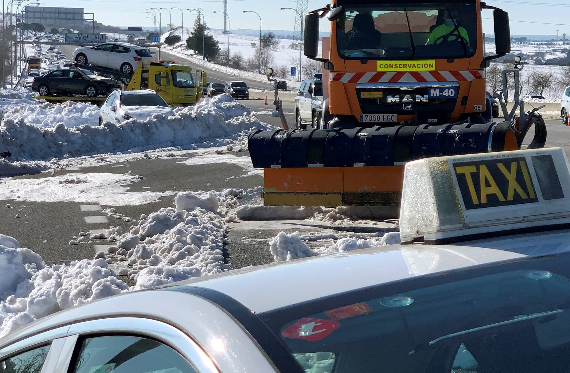 A taxi is towed on M-40 highway after heavy snowfall in Madrid