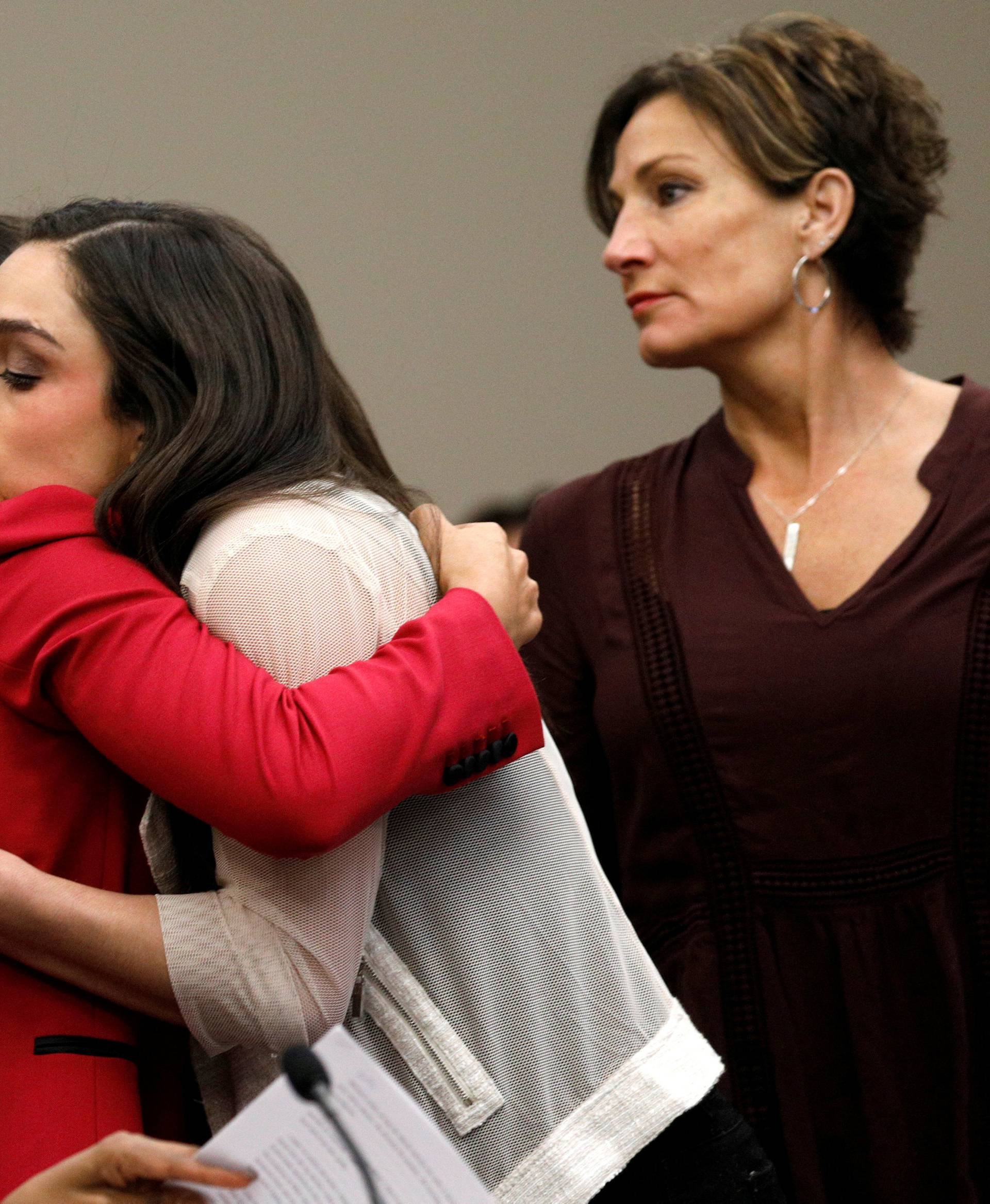 Victim and Olympic gold medalist Aly Raisman embraces former USA teammate Jordyn Wieber at the sentencing hearing for Larry Nassar, a former team USA Gymnastics doctor who pleaded guilty in November 2017 to sexual assault charges, in Lansing