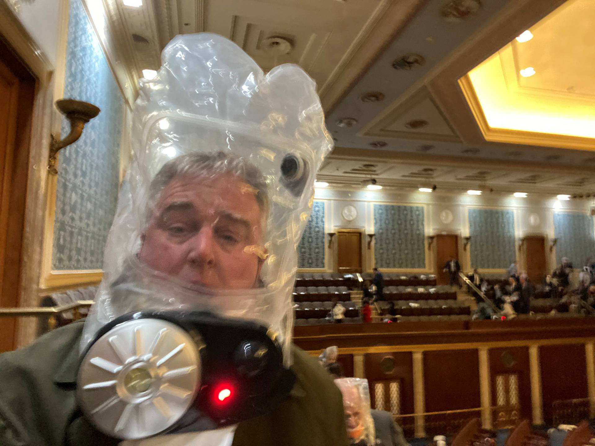 Rep. David Trone wears a gas mask inside the U.S. Capitol in Washington