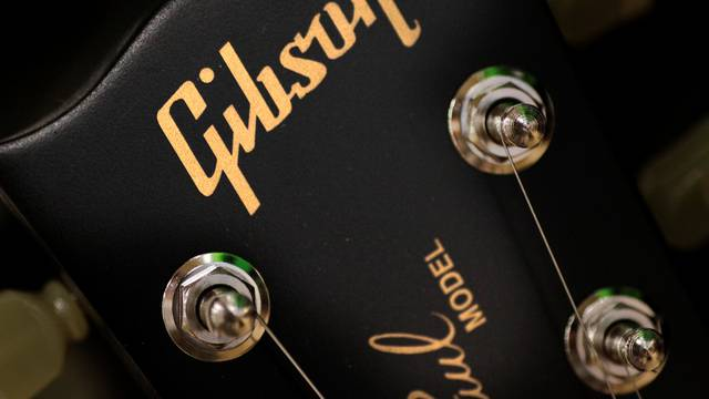 The Gibson logo is seen on a Les Paul guitar at a music store in Singapore