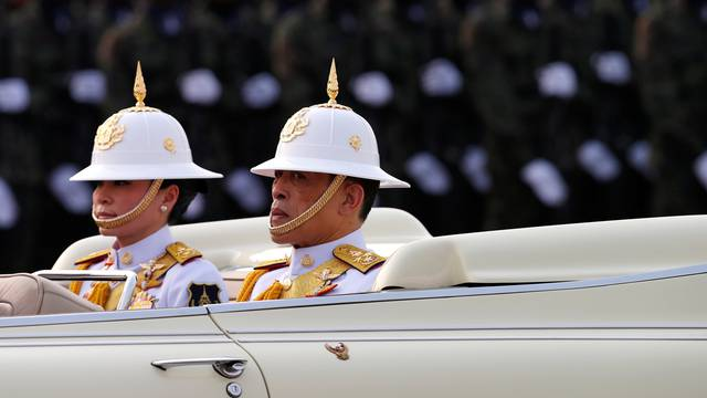 King Maha Vajiralongkorn and Queen Suthida attend the annual Military Parade to celebrate the Coronation of King Rama X at the Royal Thai Army Cavalry Center in Saraburi province