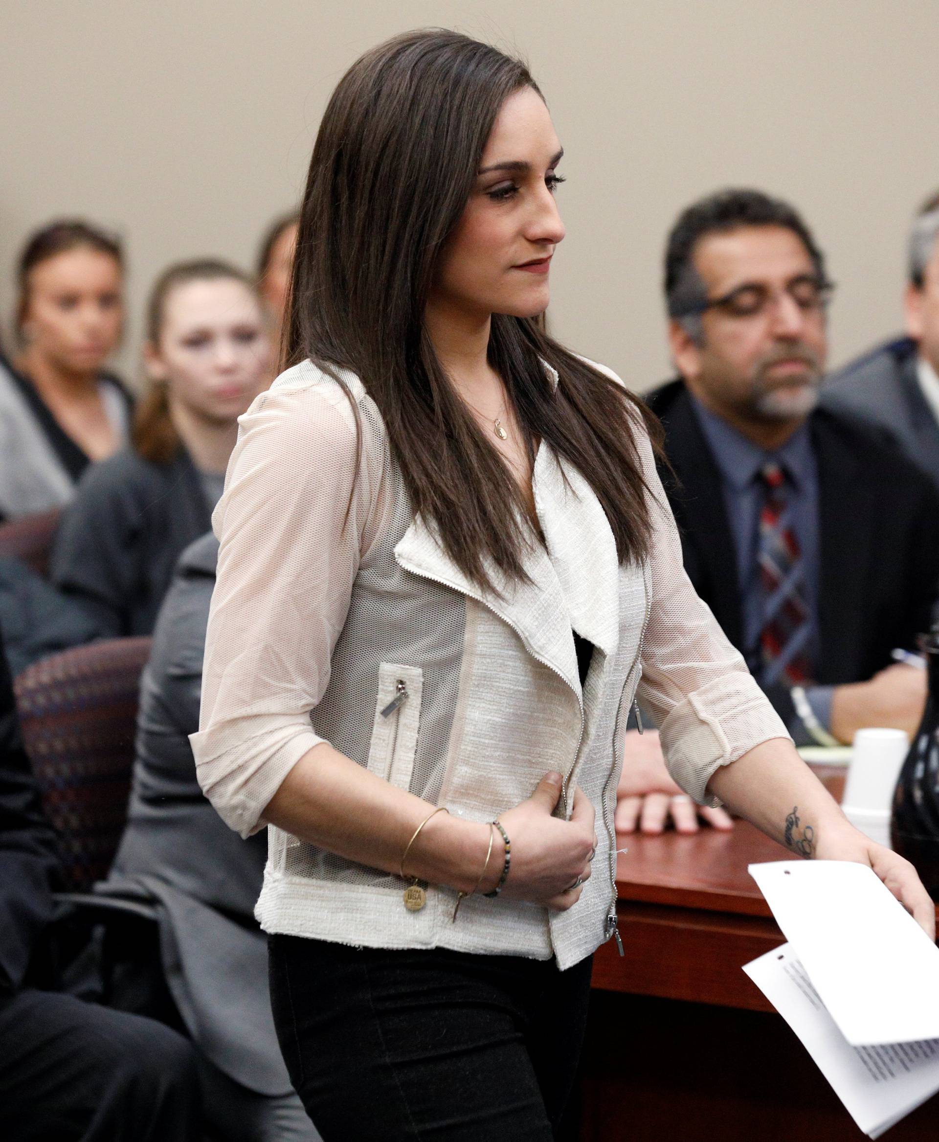 Victim and former gymnast Jordyn Wieber walks to the podium to speak at the sentencing hearing for Larry Nassar, a former team USA Gymnastics doctor who pleaded guilty in November 2017 to sexual assault charges, in Lansing