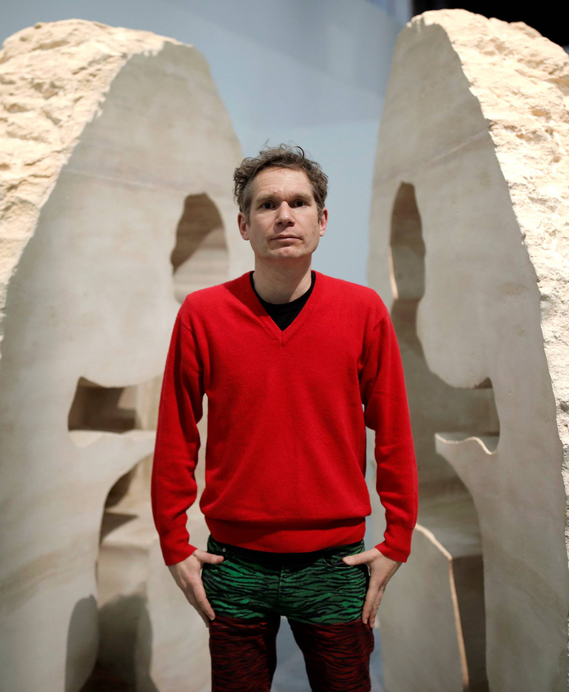 "French artist Abraham Poincheval poses in front of his artwork Pierre (""Stone"") in Paris"