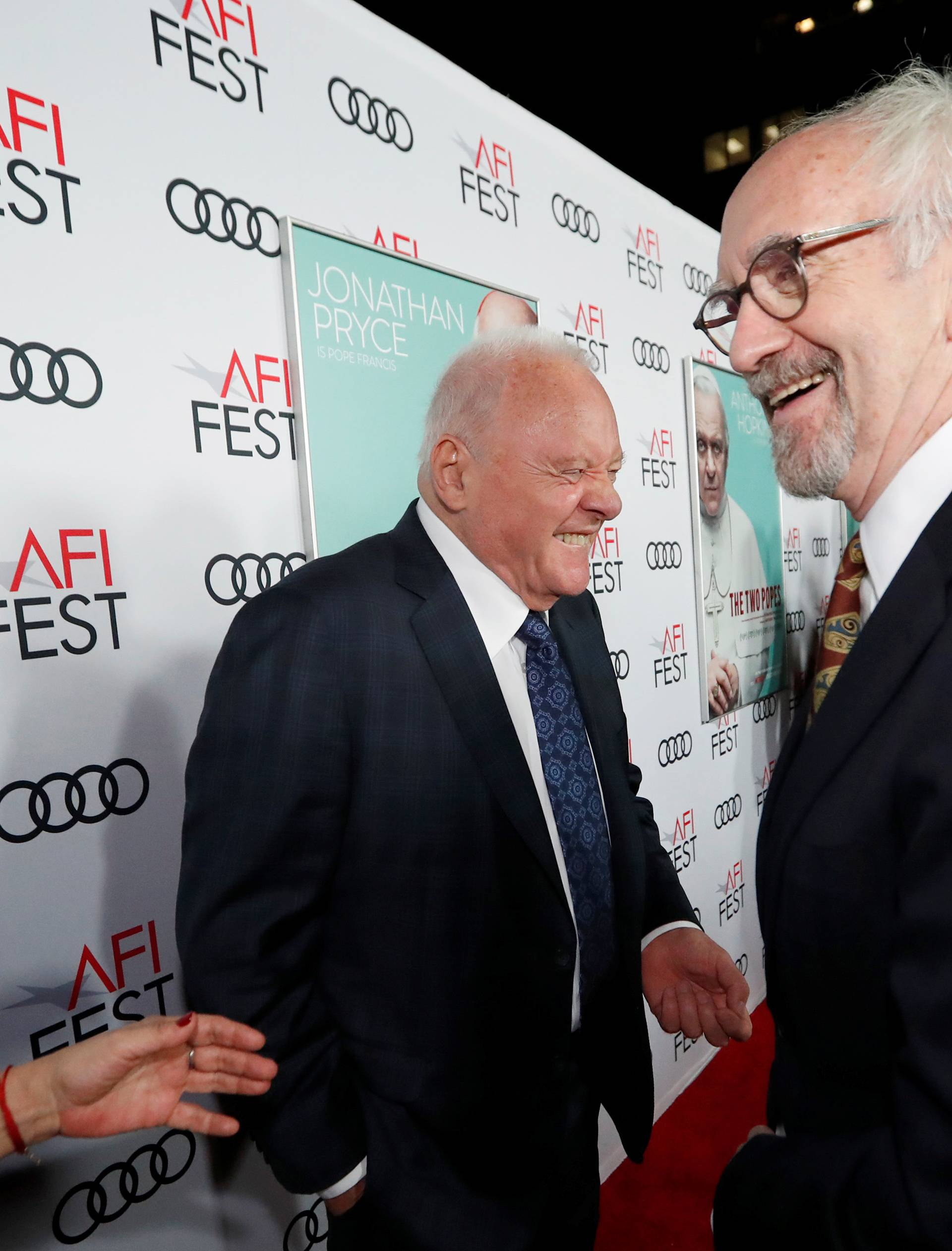 "Cast members Pryce and Hopkins greet each other at a premiere for the film ""The Two Popes"" during AFI Fest 2019 in Los Angeles"