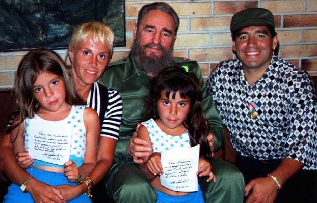 FILE PHOTO: Cuban President Fidel Castro poses with Argentine soccer star Diego Maradona