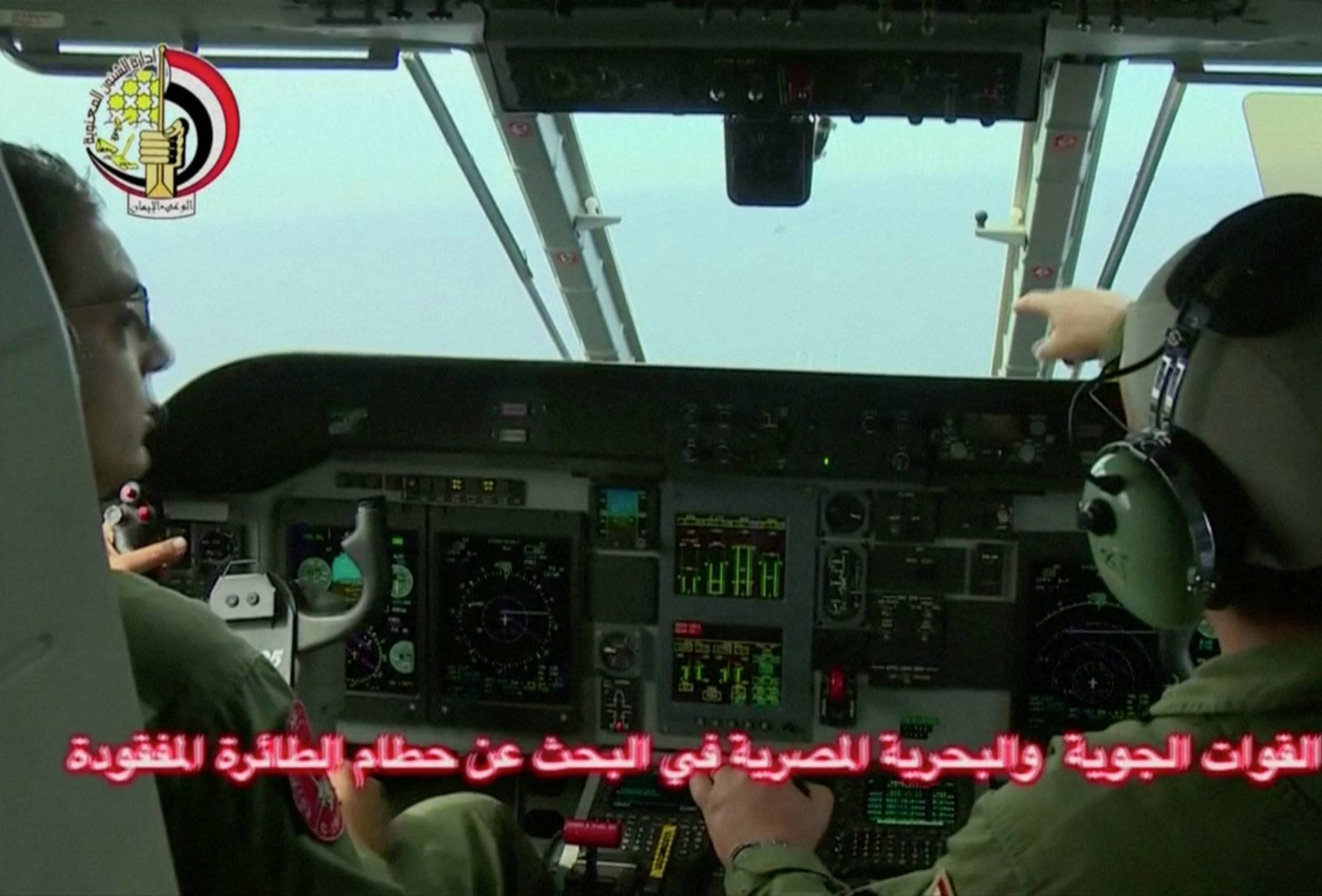 An Egyptian pilot points during a search operation by Egyptian air and navy forces for the EgyptAir plane that disappeared in the Mediterranean Sea, in this still image taken from video
