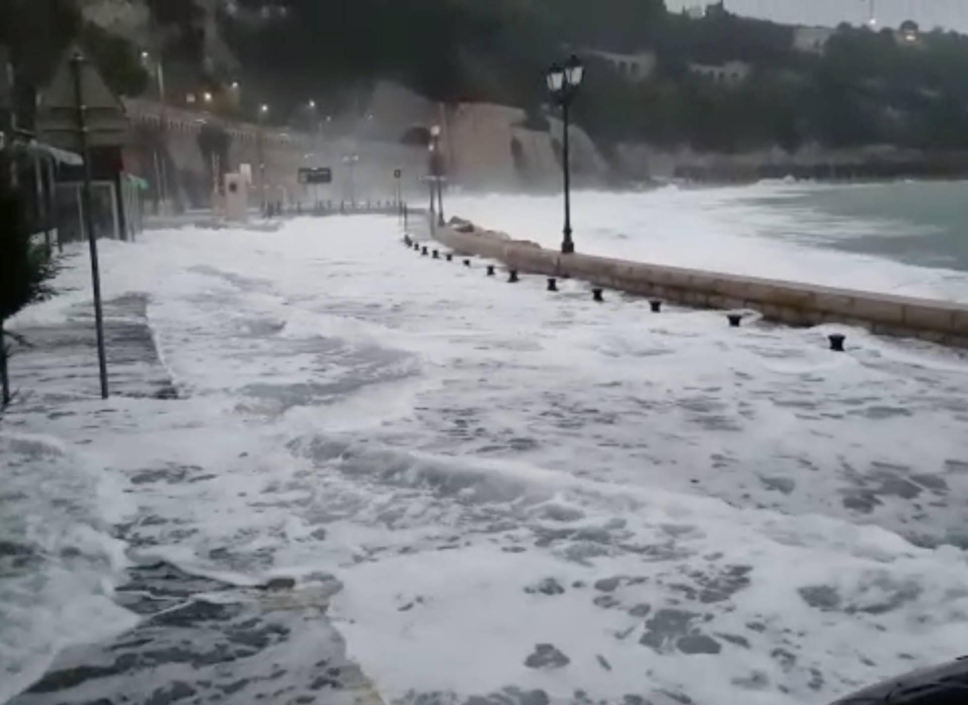 Waves flood the street in Villefranche-Sur-Mer