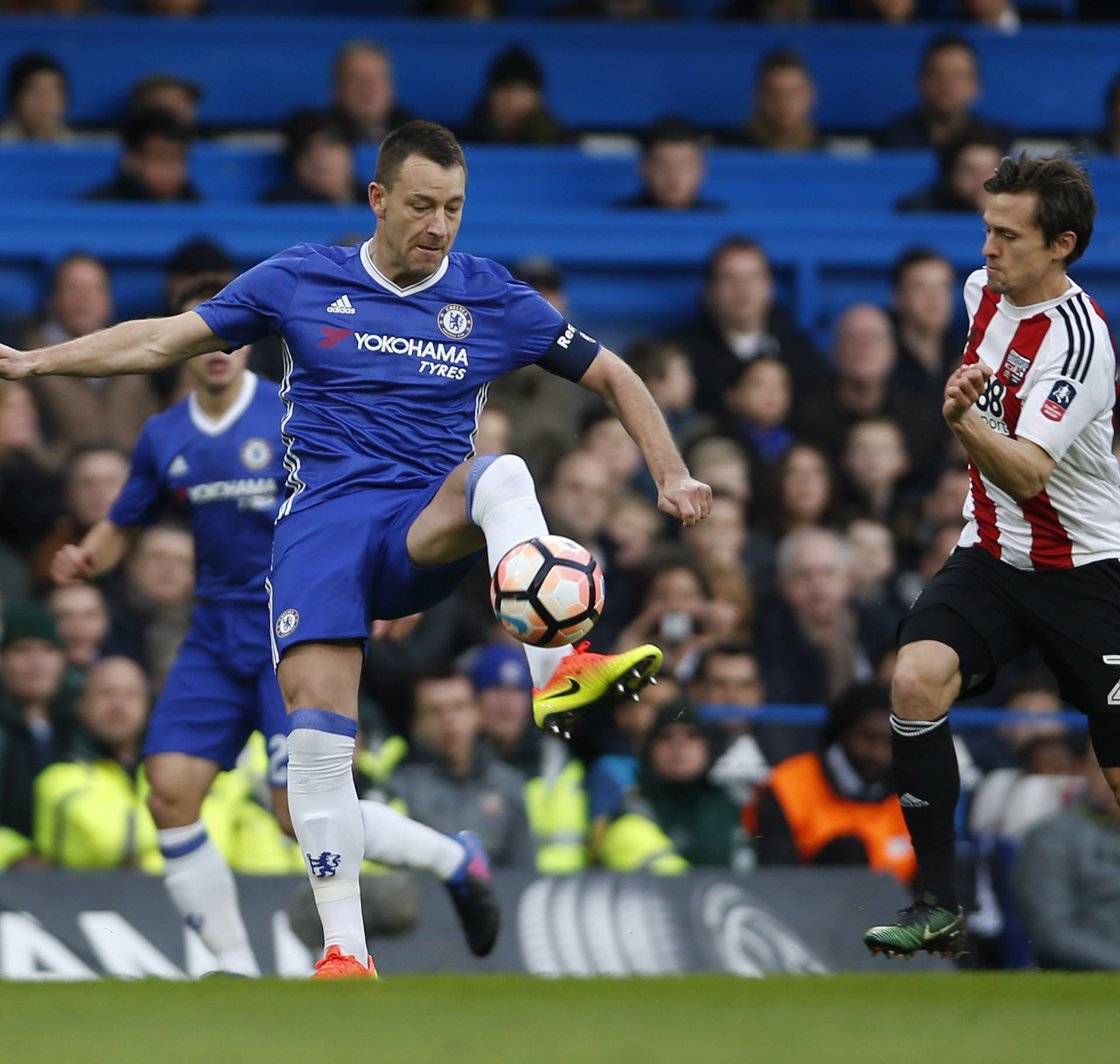 Chelsea's John Terry in action with Brentford's Lasse Vibe