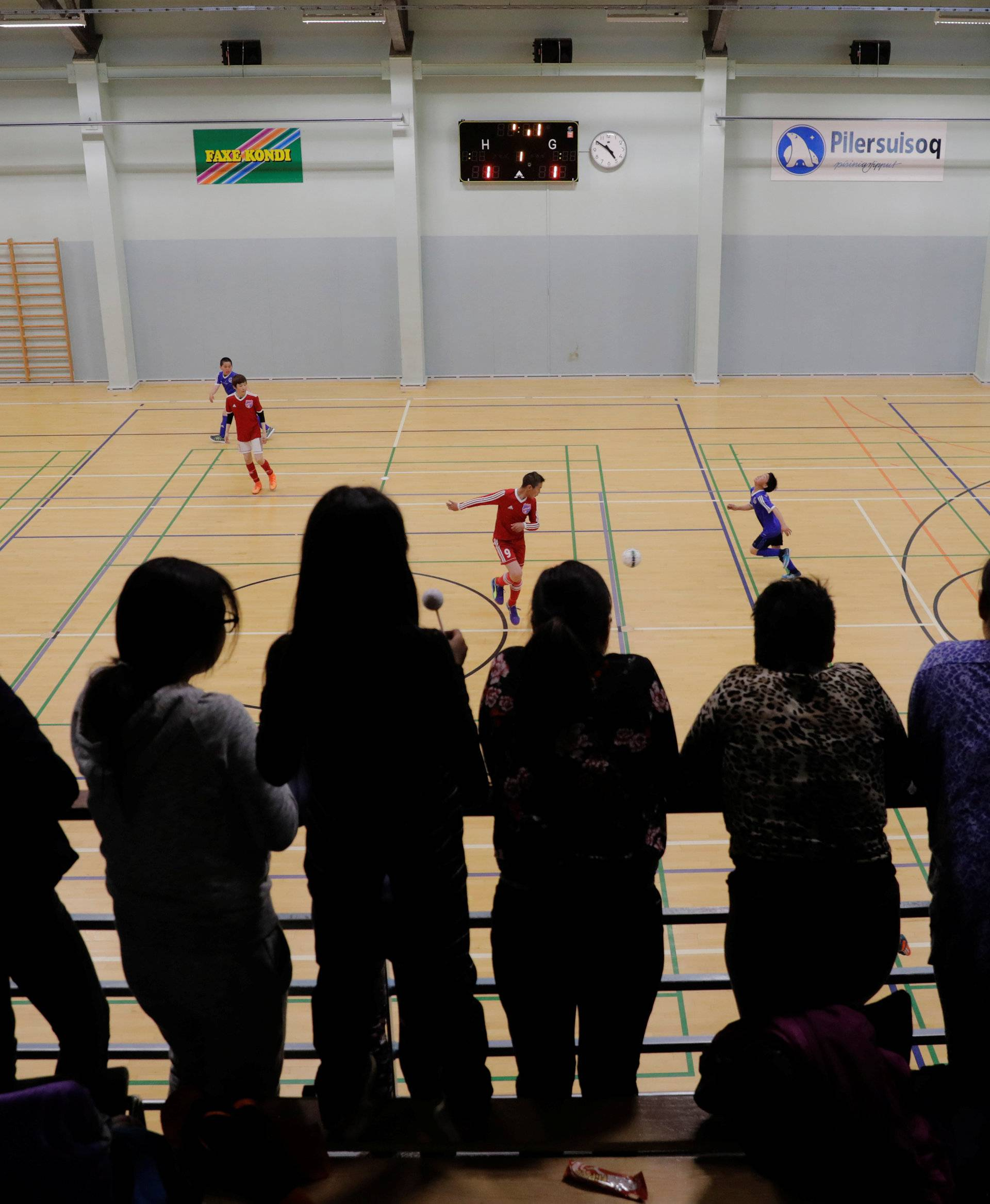 Residents watch an indoor soccer tournament in Tasiilaq, Greenland