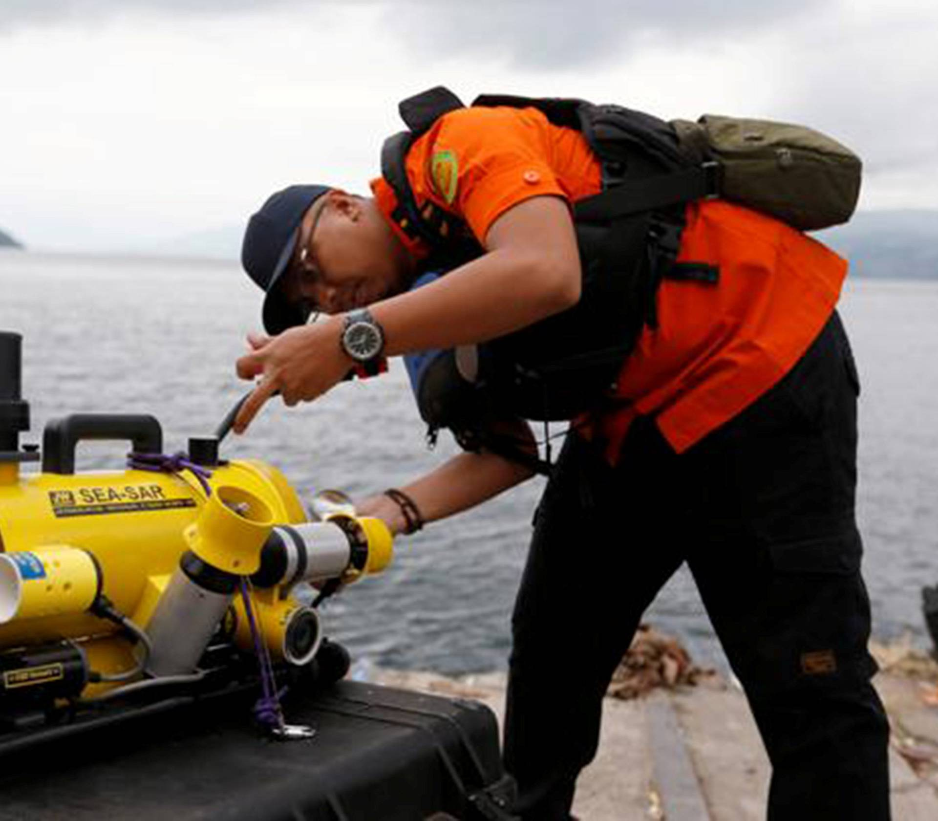 A rescue personnel prepares a ROV before starting to find the location of the Lion Air plane crash in the sea in Karawang regency