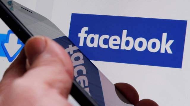 FILE PHOTO: The Facebook logo is displayed on the company's website in Bordeaux, France