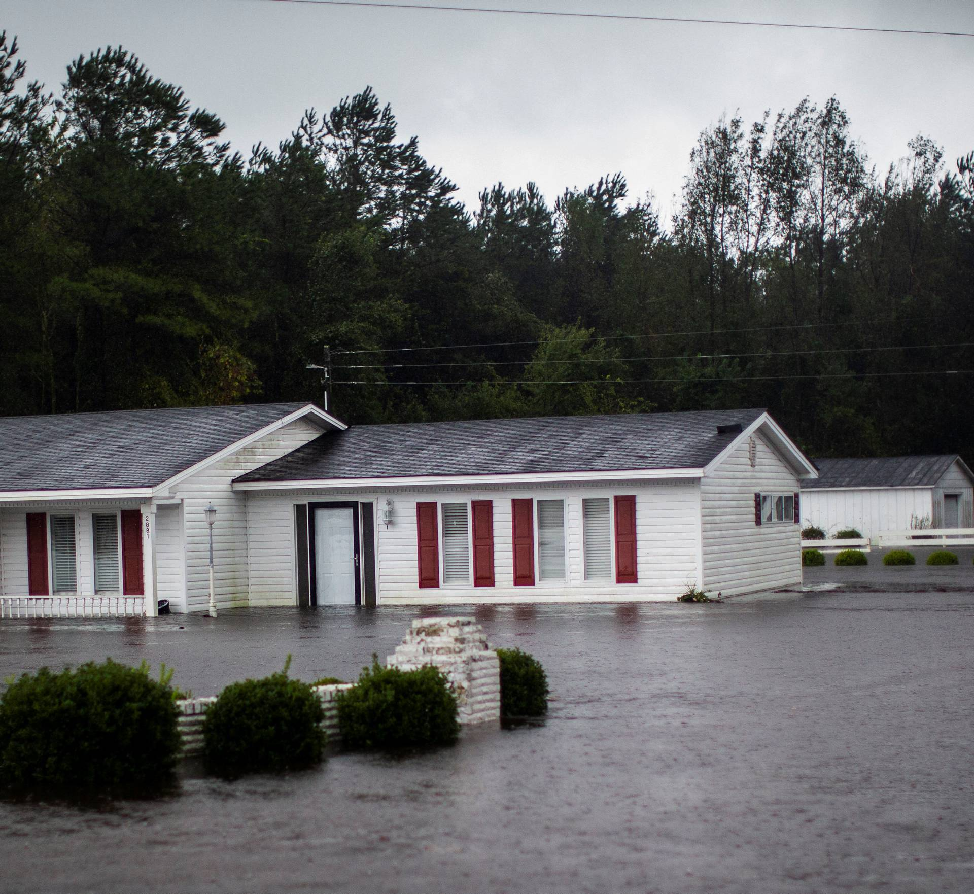 A house is seen flooded by rain after Hurricane Florence swept through the town of Wallace