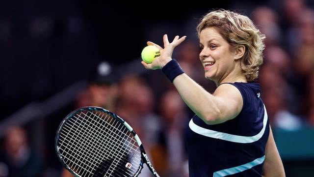 FILE PHOTO: Belgium's Clijsters waves to supporters during an exhibition tennis match to mark her retirement