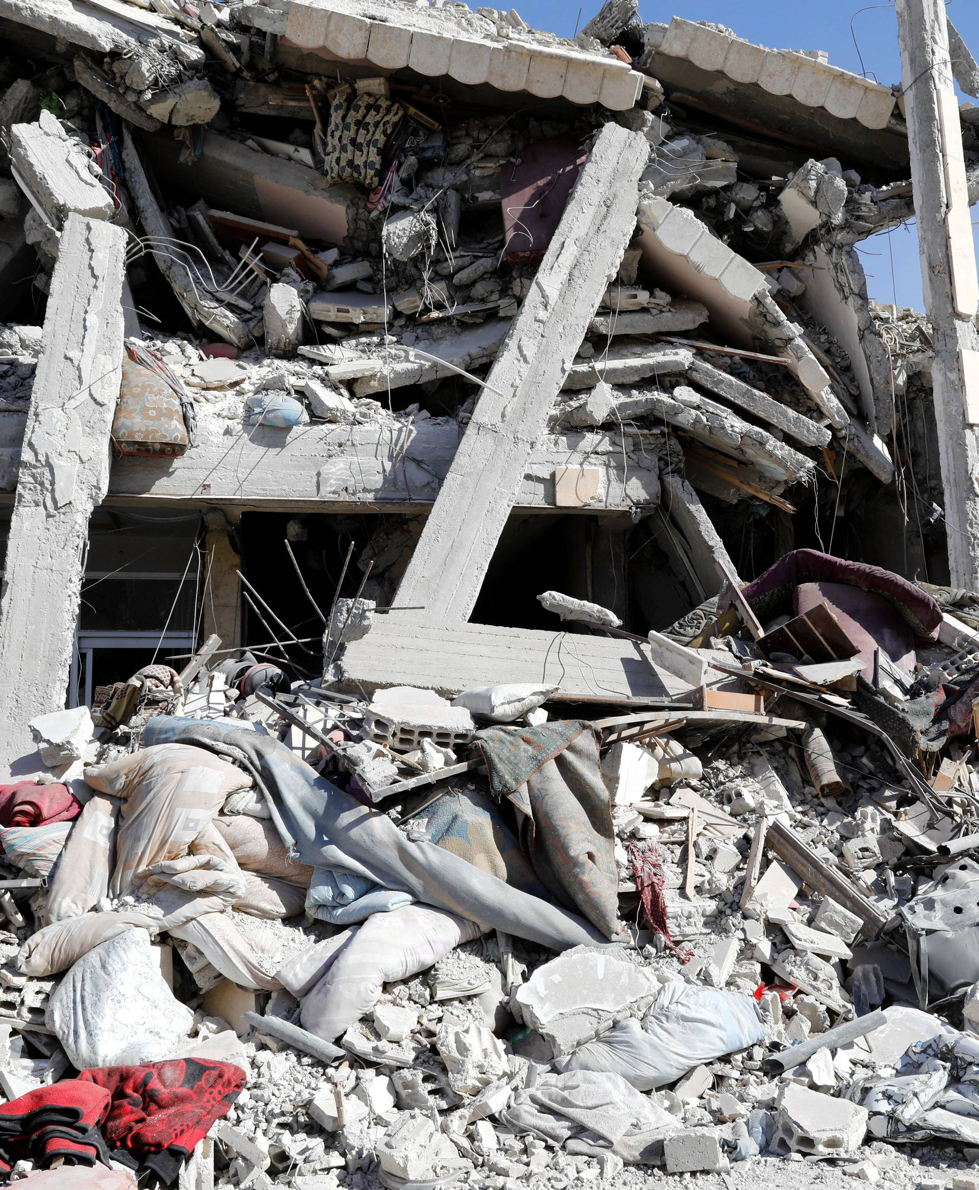 General view of a collapsed building due to fighting in Raqqa's old city in Syria