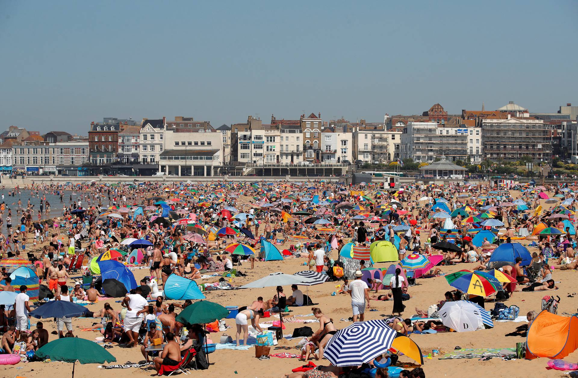People enjoy the hot weather on Margate beach in Margate