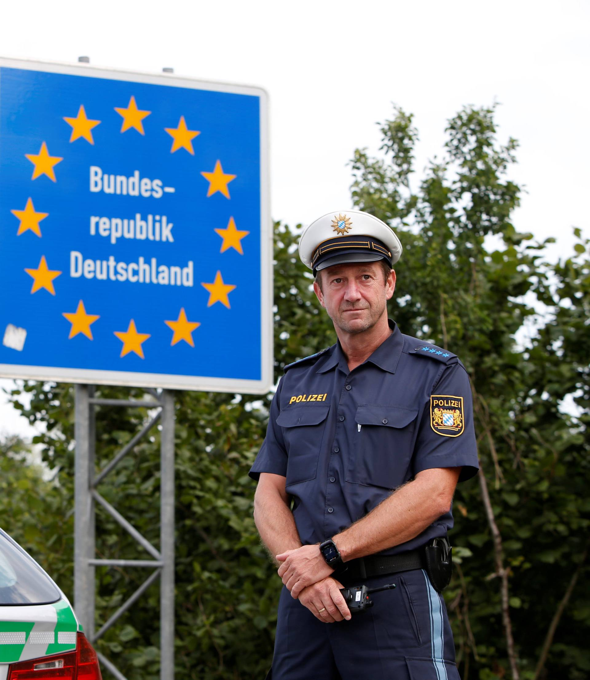 Bavarian Police Officers control cars at a temporarily checkpoint on the motorway between the Austrian and German border in Kirchdorf am Inn