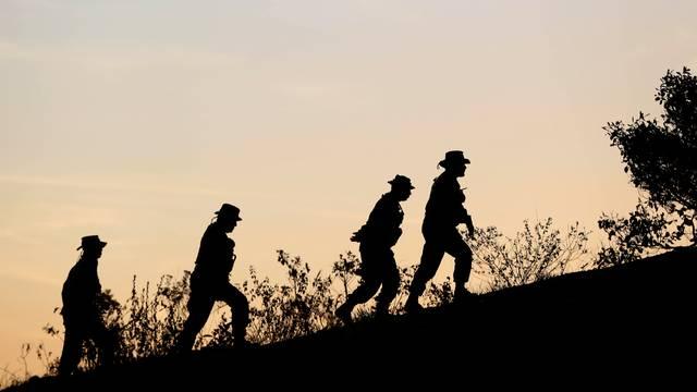 Venezuelan soldiers patrol along the border between Venezuela and Brazil in Pacaraima