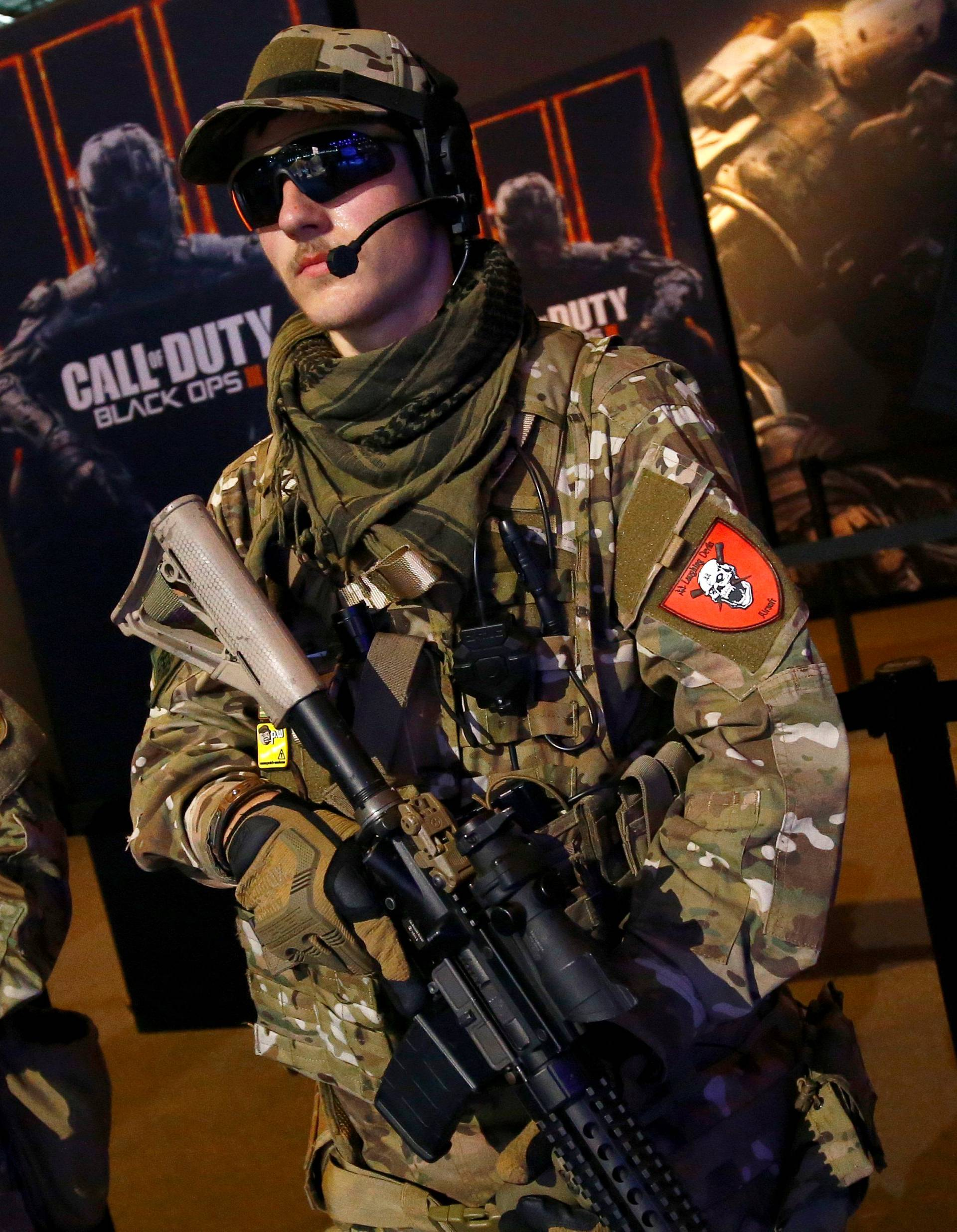 """Men are dressed as soldiers to promote the video game """"Call Of Duty Black Ops 3"""" at the Gamescom fair in Cologne"""