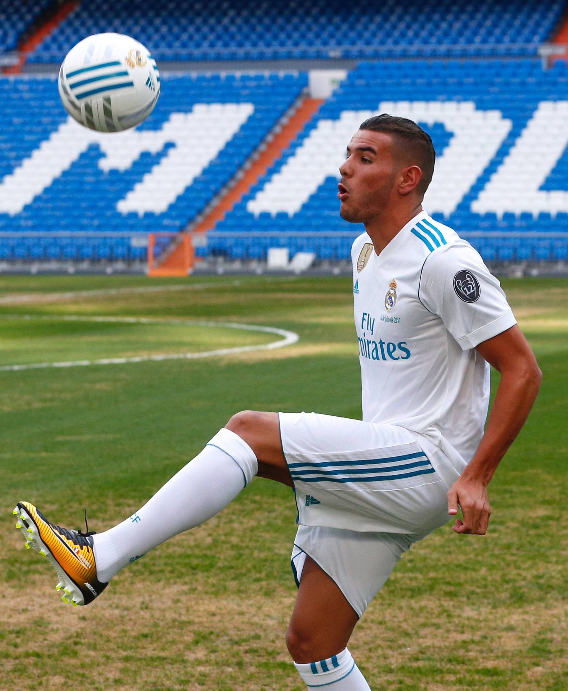 Real Madrid's new player Theo Hernandez controls the ball during his presentation at the Santiago Bernabeu Stadium in Madrid